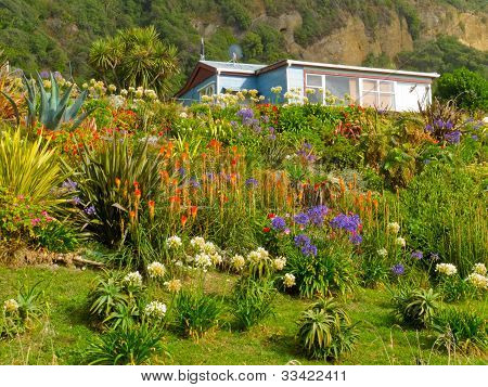 Rural dream house in lush flowering natural garden