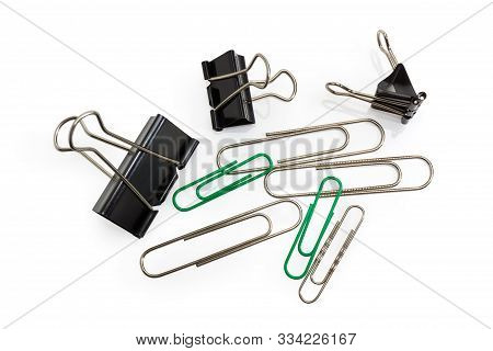 Binder Paper Clips And Traditional Steel Wire Paper Clips Oblong Looped Shape Different Sizes On A W