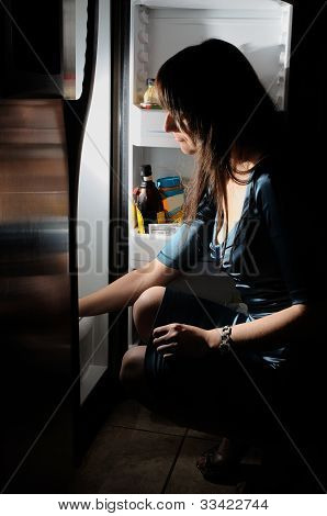 Young Woman By A Fridge