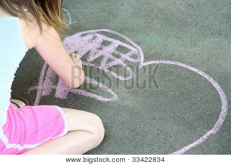 Little girl with chalk