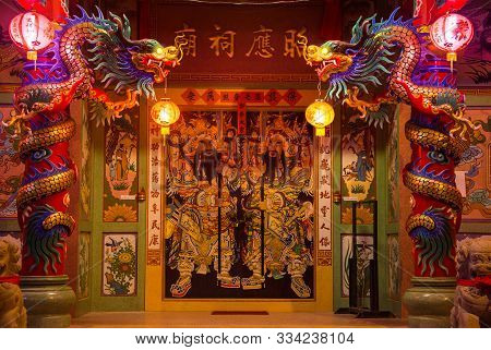 Koh Samui, Thailand - March 1, 2019: Entrance To The Chinese Temple Guardered By Dragons On Pillars