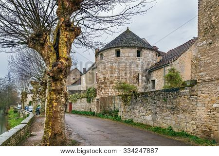 Street With Tower And Wall Street Along Serein River In Noyers, Yonne, France