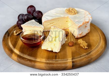 Close Up Of Soft Cheese On Wooden Tray