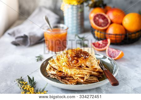 Pancakes With Jam Or Marmalade Made From Red Orange. Tasty Breakfast. Crepe Suzette Pancakes With Or