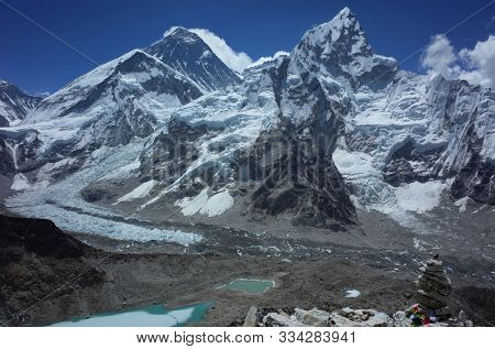 Everest trek, View from Kala Patthar (5550 m) of Khumbu Glacier, Everest (dark mountain in the middle with clouds blowing) and Nuptse mountain. Sagarmatha national park, Solukhumbu, Himalayas, Nepal