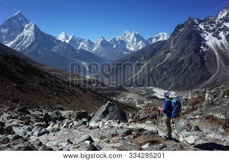Everest trek, Hiker is enjoying the view of Himalayas with Ama Dablam mountain. Sagarmatha national park, Solukhumbu, Nepal