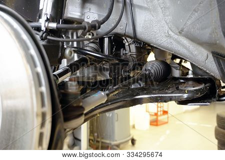 Elements And Structure Of The Front Suspension Of A Modern Car. Close-up Of The Front Suspension Arm