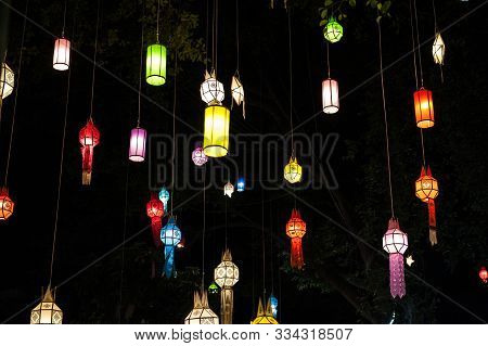 Sky Lanterns, Flying Lanterns, Floating Lanterns, Hot-air Balloons On Dark Night Sky With Moon. New