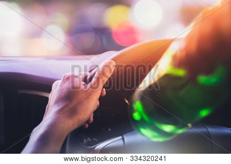 Drinking And Driving , Man Drinking Alcohol While Driving Car After Party At Night Time