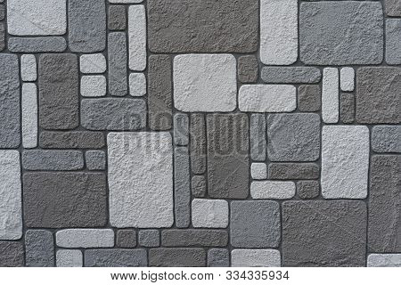 Stone Wall As Background And Texture.stone Wall As Background And Texture