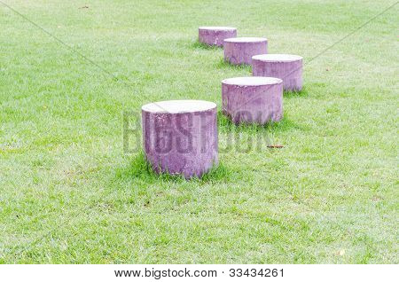 Timber is arranged on the grass