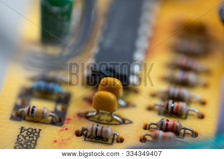 Transistors And Resistors In Macro Photography On A Microchip.transistors And Resistors In Macro Pho