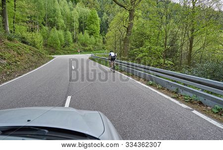 Photo From The Window Of A Car That Rides Along A Road Along The Forest Of Schwarzwald, Germany And