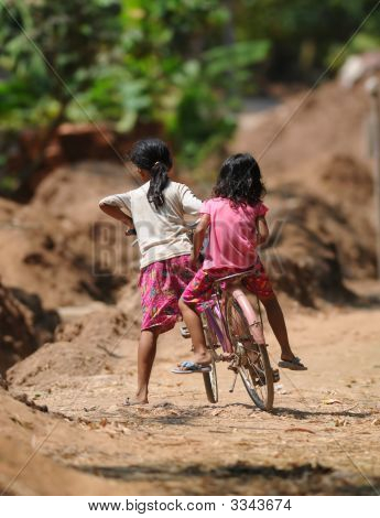 Two Cambodian Kids On One Bicycle