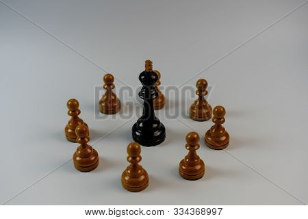 Chess Pieces, Black King Surrounded By White Pawns.chess Pieces, Black King Surrounded By White Pawn