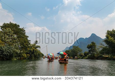 Bamboo Rafts On Yulong (dragon) River On Rainy Day. China. Yulong River Rafting Is Main Tourist Acti