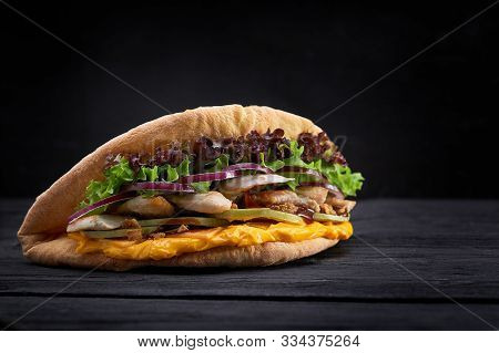 Doner Kebab - Fried Chicken Meat With Vegetables In Pita Bread