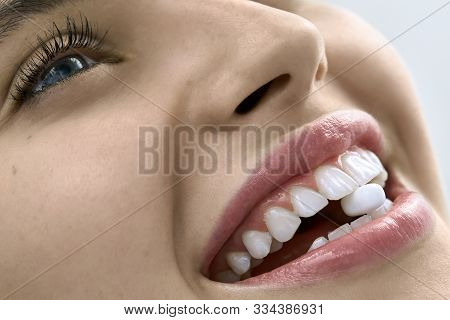 Closeup View At Womans Mouth With Perfect Teeth