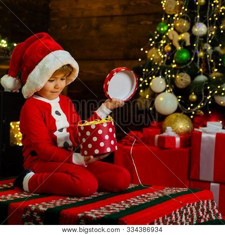 Merry And Bright Christmas. Lovely Baby Enjoy Christmas. Childhood Memories. Santa Boy Little Child