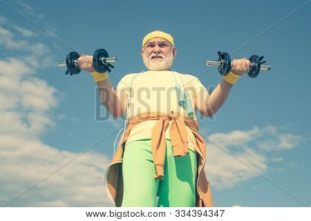 Healthcare Cheerful Lifestyle. Senior Man Lifting Dumbbell. Freedom Retirement Concept. Age Is No Ex