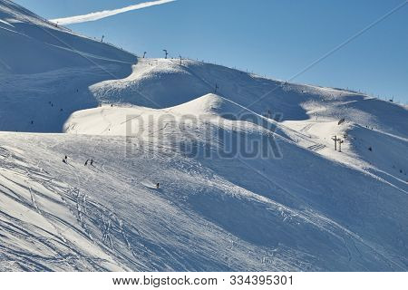 poster of Ski slopes in the French Alpes, people skiing in the distance