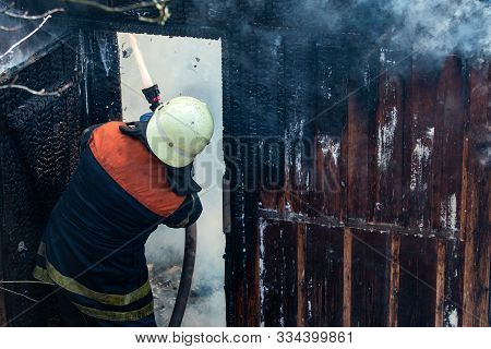 Firefighter Work Concept. Firefighter Are Using Water In Fire Fighting Operation. Real Brave Hero Co