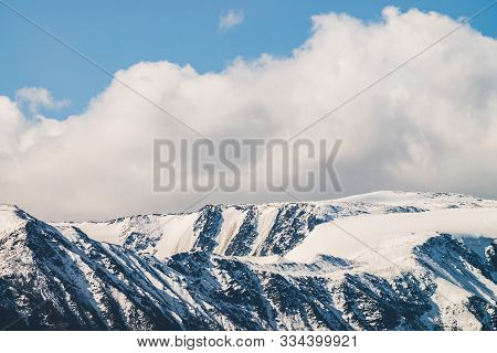 Atmospheric Alpine Landscape To Snowy Mountain Ridge In Sunny Day. Snow Shines In Day Light On Mount