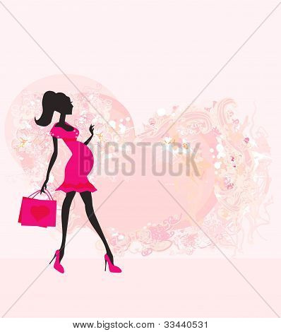 Beautiful pregnant woman on shopping for her new baby- abstract background