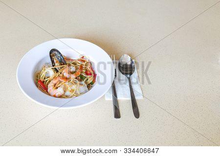 Food On Table Concept. Spicy Seafood Spaghetti Aglio Olio.