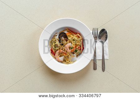 Food On Table Concept. Spicy Seafood Spaghetti Aglio Olio. Flat Lay Top Down View.