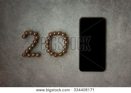 Digit 20 Made Of Bullets. Cartridges From Firearms Are Laid Out In The Form Of Numbers 20. Near On T