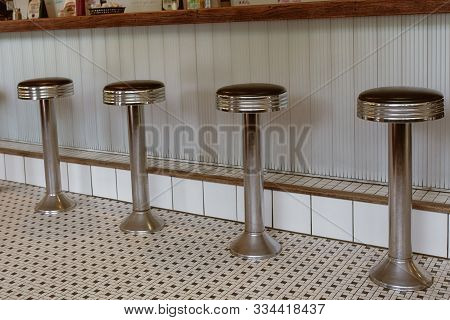 Close-up Of Counter Stools At A Classic New England Diner In A Small Town In Vermont.
