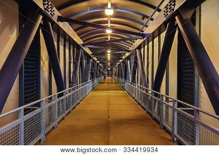 Blue Metallic Glass Overpass Pedestrian Crossing. Indoor Aerial Pedestrian Crossing. Overhead Pedest