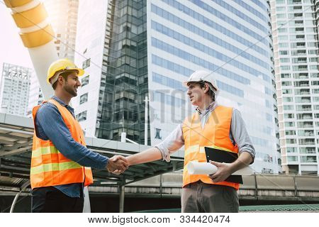 Engineer Boss Get Handshake, Saying Thank You To Blue Collar Worker Or Team For Doing Work Successfu