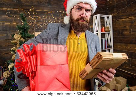 Gifts Delivery Service. Letter For Santa Claus. Post For Santa Claus. Man Bearded Hipster Wear Santa
