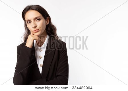 Beautiful Business Woman Thinking Her Future Life Of Business. Working Woman Looks At Copy Space. Wh