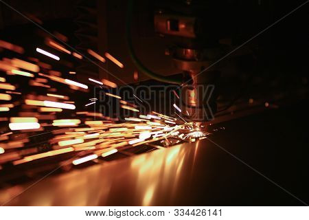 Cutting Machine With Rotating Disc. Sparks Fly Out Machine Head For Metal Processing Laser Metal On