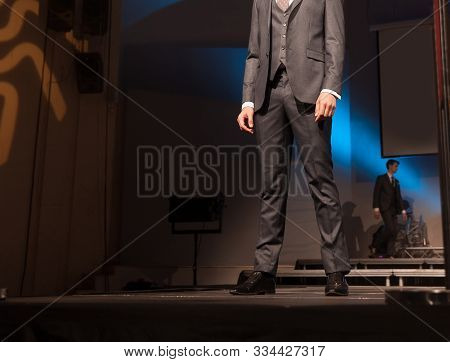 Male Model Posing On The Catwalk During A Fashion Show