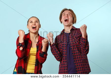 Excited Happy Young Family Couple Winners Celebrate Win Motivated By Triumph Rejoice Victory Success