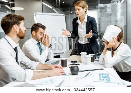 Female Top Manager Or Team Leader Quarreling At Employees, Dissatisfied With Their Work During A Con