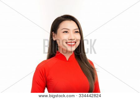 Vietnamese Woman In Red Ao Dai Dress Smile. Happy Lunar New Year Concept