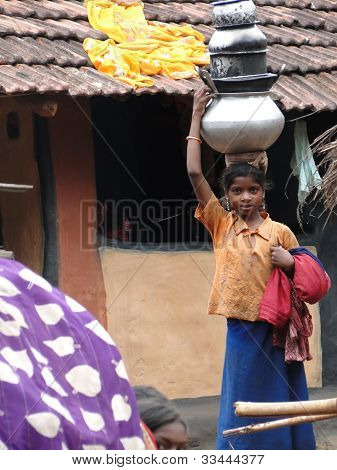 Young Girls Learn To Carry Water Pots On Their Heads