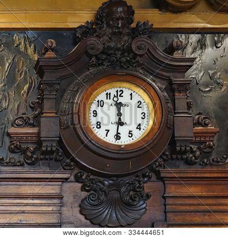 Café Brasileira - Chiado, Lisboa, Portugal - 02 December 2017: Ancient Wall Clock From Carved Wood.