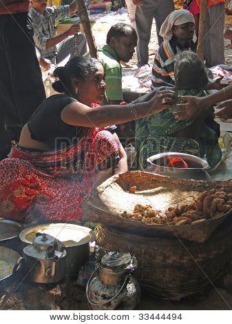 Tribal Woman Sells Freshly Made Snacks
