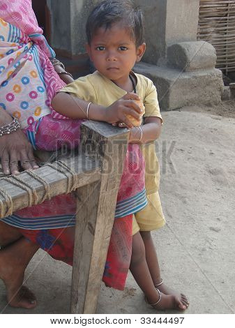 Tribal Mother And Her Child Pose For Portrait