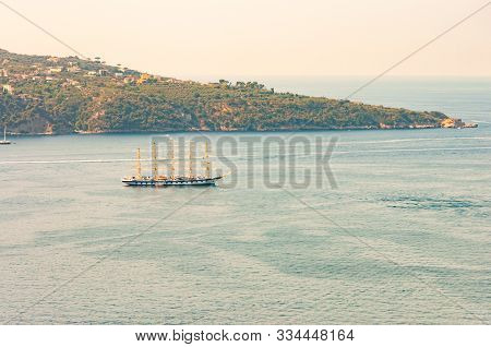 Medieval Sailing With Five Masts Floating In Near The Tyrrhenian Sea Bay Near The Rocky Surroundings