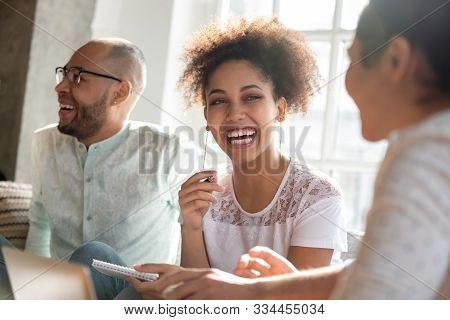 Young African American Girl Laughing At Indian Friends Funny Joke.