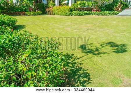 Green Grass, Modern House With Beautiful Landscaped Front Yard, Lawn And Garden Blur Background., Th