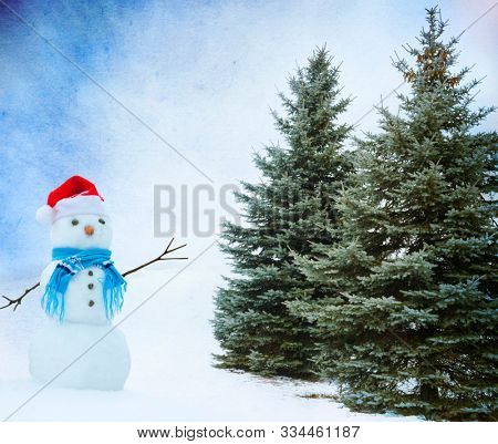 Snowmen standing in a winter landscape with Christmas trees.Background with snowman.