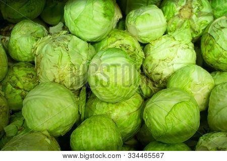 Group Of Green Cabbages In A Supermarket, Cabbage Background, Fresh Cabbage From Farm Field, A Lot O